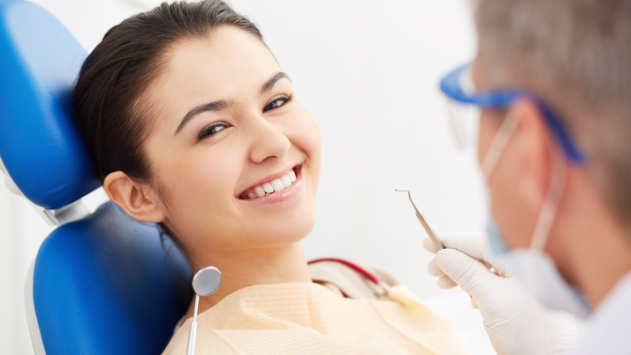 girl smiling in dental chair